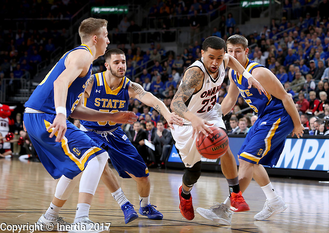 SIOUX FALLS, SD: MARCH 7: Marcus Tyus #23 from Omaha splits three defenders including Michael Orris #50, Reed Tellinghuisen #23 and Lane Severyn #25 from South Dakota State University during the Men's Summit League Basketball Championship Game on March 7, 2017 at the Denny Sanford Premier Center in Sioux Falls, SD. (Photo by Dave Eggen/Inertia)