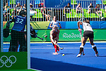 Kathleen Sharkey #24 of United States passes the ball across the goalmouth during USA vs Germany in a women's quarterfinal game at the Rio 2016 Olympics at the Olympic Hockey Centre in Rio de Janeiro, Brazil.