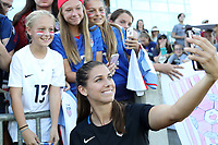 Cary, NC - Sunday October 22, 2017: Alex Morgan takes a selfie with fans after an International friendly match between the Women's National teams of the United States (USA) and South Korea (KOR) at Sahlen's Stadium at WakeMed Soccer Park. The U.S. won the game 6-0.