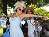 Alyssa Olson of Bellmore poses for a picture as she makes her entrance into Belmont Park for the 150th running of the Belmont Stakes on Saturday, June 9, 2018