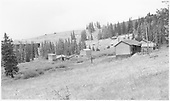 D&amp;RGW MoW facilities at Marshall Pass summit.  The Marshall Pass snowshed is in the left center distance and the section house, bunkhouses and various sheds are in the foreground.<br /> D&amp;RGW  Marshall Pass, CO  Taken by Richardson, Robert W. - 9/1955
