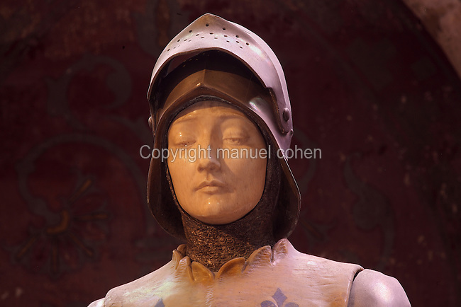 Face of statue of Joan of Arc, 'Jehanne au sacre', 1901, by Prosper díEpinal, in an apsidal chapel in the Cathedrale Notre-Dame de Reims or Reims Cathedral, Reims, Champagne-Ardenne, France. Her armour is bronze, her face ivory, and her tunic is yellow marble with fleurs de lys incrusted with lapis lazuli. The cathedral was built 1211-75 in French Gothic style with work continuing into the 14th century, and was listed as a UNESCO World Heritage Site in 1991. Picture by Manuel Cohen