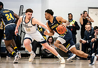 WASHINGTON, DC - FEBRUARY 22: Jamison Battle #10 of George Washington defends against Sherif Kenney #4 of La Salle during a game between La Salle and George Washington at Charles E Smith Center on February 22, 2020 in Washington, DC.