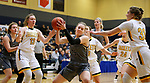 RAPID CITY, SD: DECEMBER 1:  Molly McCabe #25 of South Dakota Mines is surrounded by Black Hills State defender during their Rocky Mountain Athletic Conference women's basketball game Saturday evening at the King Center Rapid City, S.D.  (Photo by Richard Carlson/dakotapress.org)