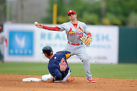 St. Louis Cardinals shortstop Pete Kozma #38 throws to first as Rick Ankiel #46 slides in during a Spring Training game against the Houston Astros at Osceola County Stadium on March 1, 2013 in Kissimmee, Florida.  The game ended in a tie at 8-8.  (Mike Janes/Four Seam Images)