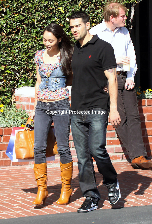 Feb 25th 2010..Jesse Metcalfe walking with his arm around his new girl friend after shopping at Fred Segal in Hollywood California. Jesse was wearing Nike Velcro shoes. ..AbilityFilms@yahoo.com.805-427-3519.www.AbilityFilms.com