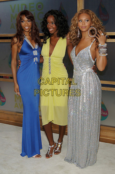 MICHELLE WILLIAMS, KELLY ROWLAND & BEYONCE KNOWLES (DESTINY'S CHILD).MTV Video Music Awards.Arrivals held at the American Airlines Arena,.Miami, 28th August 2005.full length blue lime green yellow silver dress bangles hand hoop big earring.Ref: ADM/JW.www.capitalpictures.com.sales@capitalpictures.com.© Capital Pictures.v-neck plunging neckline