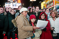 "New York, NY -  21 December 2012 Over 500 people filled the red steps in Times Square to sing Lennon's song ""Imagine""  Several hundred more gathered in the mall of Duffy Square to sing along...The song was lead by Thomas McCarger, conductor and singer, and under the auspices of Make Music New York, while IMAGINE PEACE lit up the Times Square billboards at 11:57 p.m."