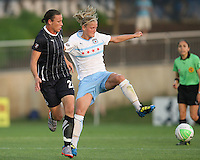 Abby Wambach #20 of the Washington Freedom challenges Katie Chapman #17 of the Chicago Red Stars during a WPS match at the Maryland Soccerplex, in Boyds Maryland on June 12 2010. The game ended in a 2-2 tie.