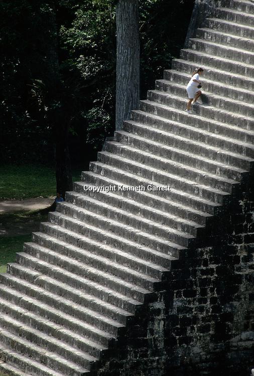 Temple 2, Maya, Tikal, tourist climbs stairs, Guatemala