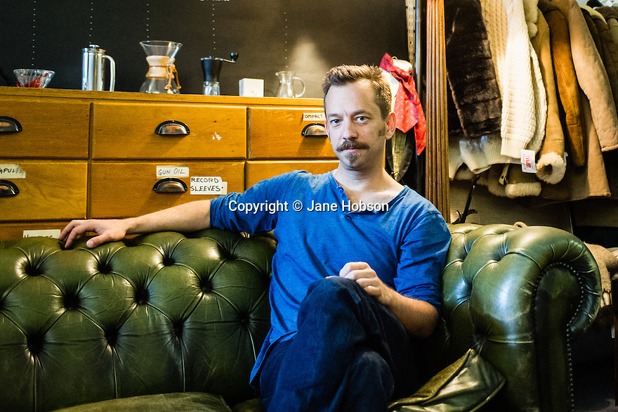 Edinburgh, UK. 16.08.2013. Joseph Alford, artistic director of Theatre O, at Avalanche Artisan Roasts record and coffee shop, Grassmarket. Joseph is directing THE SECRET AGENT, at the Traverse, as part of the Edinburgh Festival Fringe. The production is to transfer to London's Young Vic theatre. Photograph © Jane Hobson.