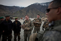 A marine briefs ANA (Afghan National Army) soldiers ahead of a joint mission from Camp Bostick close to the Pakistan border in Nuristan. The mission was a patrol to the nearby village of Nishigham to re-supply an OP (Observation Post) that had been attacked the day before killing one ANA soldier. The marines are acting as an ETT (Embedded Training Team) to mentor the ANA with the ultimate aim of leaving the country's security for the local Army to deal with.