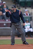 Home plate umpire Matt Neuhold makes a strike call during a Midwest League game between the Great Lakes Loons and the Dayton Dragons at Fifth Third Field April 22, 2009 in Dayton, Ohio. (Photo by Brian Westerholt / Four Seam Images)