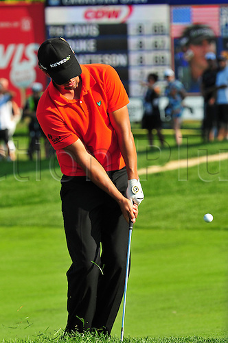 28.07.2012 Scott Piercy chips onto the 18th green in the third round of the RBC Canadian Open at Hamilton Golf and Country Club in Ancaster, Ontario.