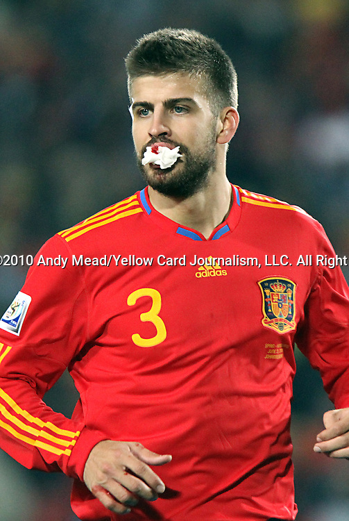 21 JUN 2010:  Gerard Pique (ESP)(3) has his bloody bottom lip packed to help stop the bleeding.  The Spain National Team defeated the Honduras National Team 2-0 at Ellis Park Stadium in Johannesburg, South Africa in a 2010 FIFA World Cup Group C match.