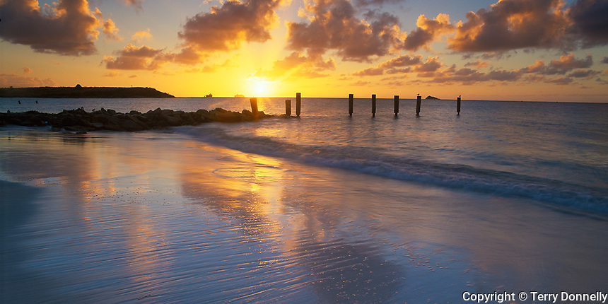 Antigua, West Indies, Leeward Caribbean Islands:  Sunset over Dickenson Bay and Corbison Point