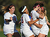 Rachel Florenz #18 of East Islip, second from right, gets mobbed by teammates, from left, Amanda Moccaldi #19, Bella Pasha #13 and Lauren Borelli #15 after scoring a goal with 7:48 remaining in the second half of a Suffolk County Class AA varsity girls soccer first round playoff game against North Babylon at East Islip High School on Monday, Oct. 24, 2016. Florenz's goal broke a scoreless tie and lifted East Islip to a 1-0 win.