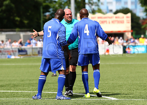 June 17th 2017, Gander Green Lane, Sutton, England; Football Charity Match; Chelsea Legends versus Rangers Legends; Chelsea's Keith Dublin and Frank Sinclair discuss the penalty decision with Referee Lewis Gordon