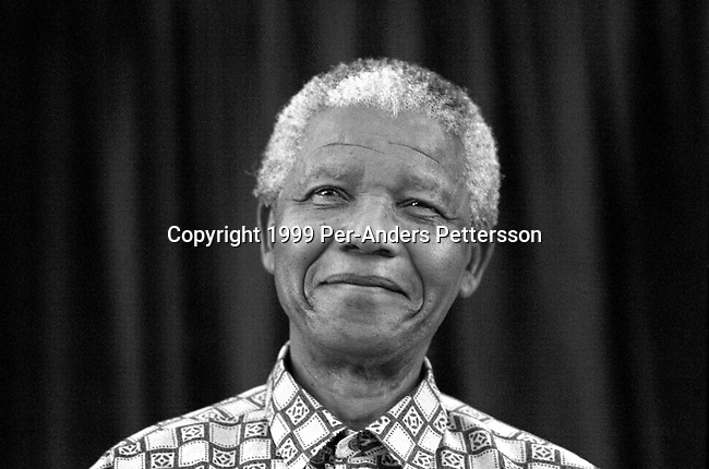 JOHANNESBURG, SOUTH AFRICA - MARCH 8: Former President Nelson Mandela of South Africa speaks to visitors on March 8, 1999 in his residence in Houghton, a suburb of Johannesburg, South Africa. The ANC freedom fighter was in prison for 27 years and released in 1990. He became President of South Africa after the first multiracial democratic elections in April 1994. Mr. Mandela retired after one term in 1999 and gave leadership to the current president Mr. Thabo Mbeki.