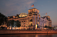 Reichstag building, opened 1894, seat of the German parliament and meeting place of the Bundestag, refurbished by Norman Foster 1990-99, including the addition of the huge glass dome, Berlin, Germany. The building sits on the river Spree. Picture by Manuel Cohen