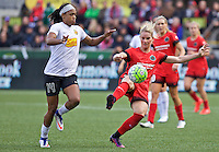 Portland, Oregon - Sunday October 2, 2016: Portland Thorns FC midfielder Amandine Henry (28) kicks the ball away from Western New York Flash forward Jessica McDonald (14) during a semi final match of the National Women's Soccer League (NWSL) at Providence Park.