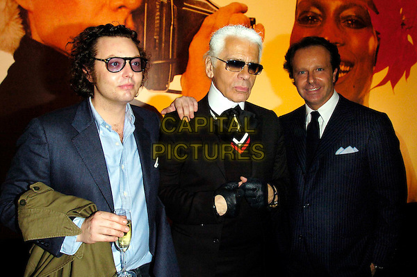 EMMANUELLE,  KARL LAGERFIELD & ANDREA.Fourth Day of the Milan Fashion Week (Milano Moda Donna) Tod's Party Woman's Collection autumn/winter 2006/07, Milan, Italy..February 21st, 2006.Ref: Garofalo/Omega/Capital Pictures.Ref: G/OME.4th half length black coat sunglasses shades gloves.www.capitalpictures.com.sales@capitalpictures.com.© Capital Pictures.