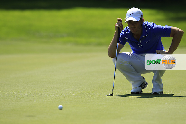 Tommy Fleetwood (ENG) lines up his putt on the 5th green during Thursday's Round 1 of the 2013 BMW International Open held on the Eichenried Golf Club, Munich, Germany. 20th June 2013<br /> (Picture: Eoin Clarke www.golffile.ie)
