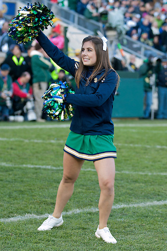 Notre Dame cheerleader Kelly Jenko performs during NCAA football game between Notre Dame and Navy.  The Notre Dame Fighting Irish defeated the Navy Midshipmen 56-14 in game at Notre Dame Stadium in South Bend, Indiana.