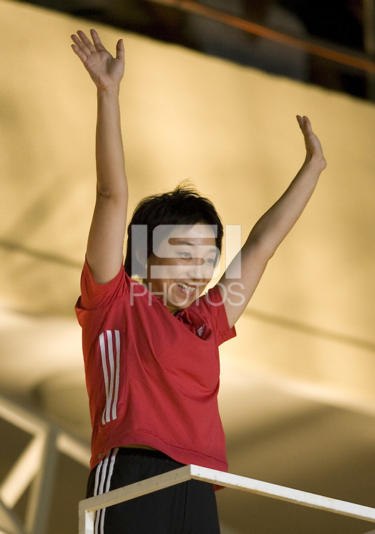 Retired Chinese forward Sun Wen salutes the crowd during the opening ceremonies for the FIFA Women's World Cup China 2007 at Hongkou Stadium in Shanghai, China on September 10, 2007.