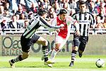 Nederland, AMsterdam, 1 April 2012.Eredivisie.Seizoen 2011-2012.Ajax-Heracles.Aras Ozbiliz van Ajax in duel om de bal met Antoine van der Linden van Heracles