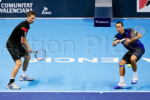 20.10.2013 Valencia, Spain. Philipp Kohlschr of Germany (R) plays a forehand  during the doubles game between Philipp Kohlschr of Germany Florian Mayer German and John Isner of USA, Feliciano Lopez of Spain and during  the Valencia Open 500 Tennis Tournament at the Agora Building