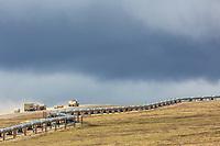 Trucks travel the James Dalton highway along the Trans Alaska Oil Pipeline in Alaska's Arctic.