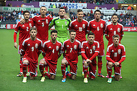 Pictured: Wales team players pose for a picture before kick off. Monday 19 May 2014<br />