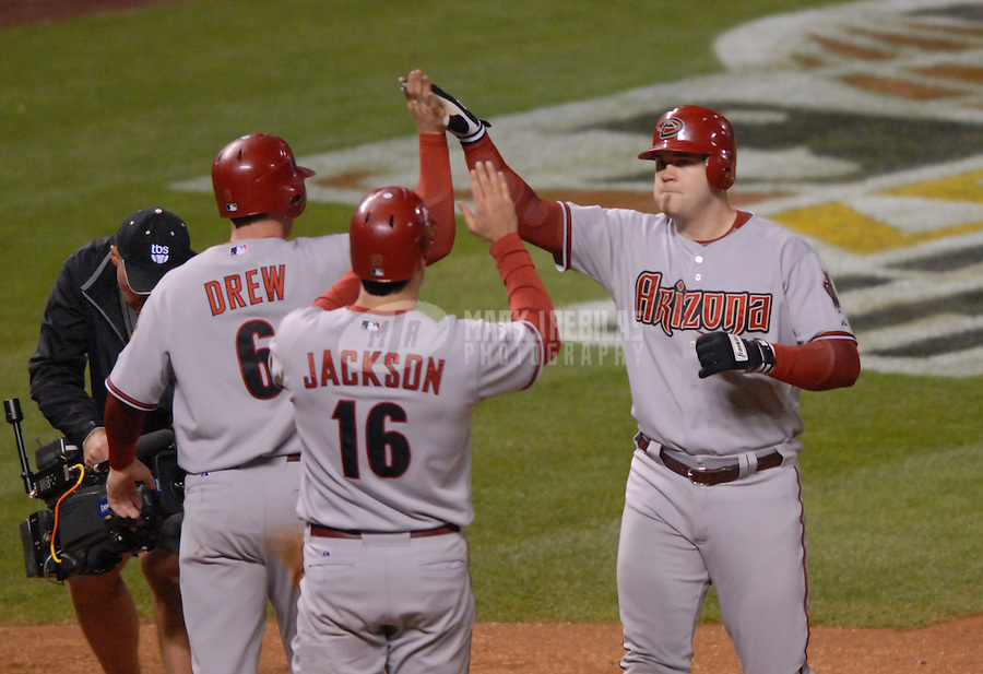 Oct 15, 2007; Denver, CO, USA; Arizona Diamondbacks catcher (19) Chris Snyder is congratulated by teammates Stephen Drew (6) and Conor Jackson (16) after hitting a two run home run in the eighth inning against the Colorado Rockies during game 4 of the 2007 National League Championship Series at Coors Field. Mandatory Credit: Mark J. Rebilas-US PRESSWIRE