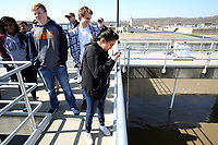 NWA Democrat-Gazette/DAVID GOTTSCHALK Mayra Lara, a junior at Rogers Heritage High School, photograph Thursday, March 1, 2018, a biological nitrification reaction treatment tank during a tour at the city of Rogers Pollution Control Facility. Junior and senior students in the Environmental Science Classes at the high school toured the facility and the Illinois River Watershed Sanctuary and Watershed Learning Center in Cave Springs.