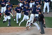 Branden Fryman (7) of the Samford Bulldogs jumps into the arms of his teammates after he scored the winning run in the bottom of the ninth inning as No. 6 seed Samford beat No. 1 seed Mercer, 5-4, at the Southern Conference Baseball Championship on Friday, May 26, 2017, at Fluor Field at the West End in Greenville, South Carolina. (Tom Priddy/Four Seam Images)