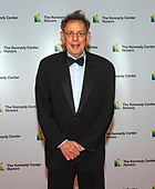 Philip Glass arrives for the formal Artist's Dinner honoring the recipients of the 41st Annual Kennedy Center Honors hosted by United States Deputy Secretary of State John J. Sullivan at the US Department of State in Washington, D.C. on Saturday, December 1, 2018. The 2018 honorees are: singer and actress Cher; composer and pianist Philip Glass; Country music entertainer Reba McEntire; and jazz saxophonist and composer Wayne Shorter. This year, the co-creators of Hamilton­ writer and actor Lin-Manuel Miranda, director Thomas Kail, choreographer Andy Blankenbuehler, and music director Alex Lacamoire will receive a unique Kennedy Center Honors as trailblazing creators of a transformative work that defies category.<br /> Credit: Ron Sachs / Pool via CNP