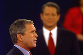 Governor George W. Bush (Republican of Texas) and United States Vice President Al Gore at the third U.S. Presidential Debate at the Field House at Washington University in St. Louis, Missouri on October 17, 2000.<br /> Credit: Dennis Brack / Pool via CNP