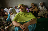 Srinagar, India-August 9, 2010: Mourners attend a funeral wake for slain teenager Fida Nabi, who was shot during a protest against India's military presence, at his family home in Srinagar