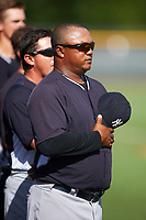 GCL Yankees West coach Julio Mosquera during the national anthem before a game against the GCL Yankees East on August 3, 2016 at the Yankees Complex in Tampa, Florida.  GCL Yankees East defeated GCL Yankees West 12-2.  (Mike Janes/Four Seam Images)
