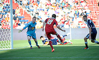 Chicago forward Chris Rolfe (18) sends a shot past New York goalkeeper Ryan Meara (18) for Chicago's third goal as defender Markus Holgersson (5) looks on.  The Chicago Fire defeated the New York Red Bulls 3-1 at Toyota Park in Bridgeview, IL on June 17, 2012.