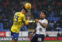 Leeds United's Kalvin Phillips clears under pressure from Bolton Wanderers' Josh Magennis<br /> <br /> Photographer Andrew Kearns/CameraSport<br /> <br /> The EFL Sky Bet Championship - Bolton Wanderers v Leeds United - Saturday 15th December 2018 - University of Bolton Stadium - Bolton<br /> <br /> World Copyright &copy; 2018 CameraSport. All rights reserved. 43 Linden Ave. Countesthorpe. Leicester. England. LE8 5PG - Tel: +44 (0) 116 277 4147 - admin@camerasport.com - www.camerasport.com