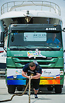 HAINAN ISLAND, CHINA - AUGUST 23:  Zydrunas Savickas of Lithuania competes at the Truck Pull event during the World's Strongest Man competition at Serenity Marina on August 23, 2013 in Hainan Island, China.  Photo by Victor Fraile