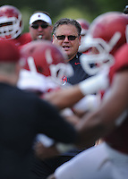 NWA Democrat-Gazette/ANDY SHUPE<br /> Arkansas offensive line coach Sam Pittman directs his players Tuesday, Aug. 11, 2015, during practice at the university's practice field in Fayetteville.