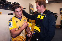 Prince Harry checks Cory Jane's hair while meeting the Hurricanes in the changing rooms after the Super Rugby match between the Hurricanes and Sharks at Westpac Stadium, Wellington, New Zealand on Saturday, 9 May 2015. Photo: Dave Lintott / lintottphoto.co.nz
