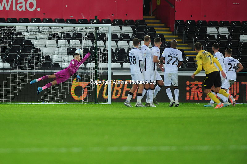 Jed Wallace of Millwall scores the opening goal during the Sky Bet Championship match between Swansea City and Millwall at the Liberty Stadium in Swansea, Wales, UK. Saturday 23rd November 2019
