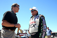 Sept. 21, 2013; Ennis, TX, USA: NHRA funny car driver John Force (right) talks with Texas governor Rick Perry during qualifying for the Fall Nationals at the Texas Motorplex. Mandatory Credit: Mark J. Rebilas-