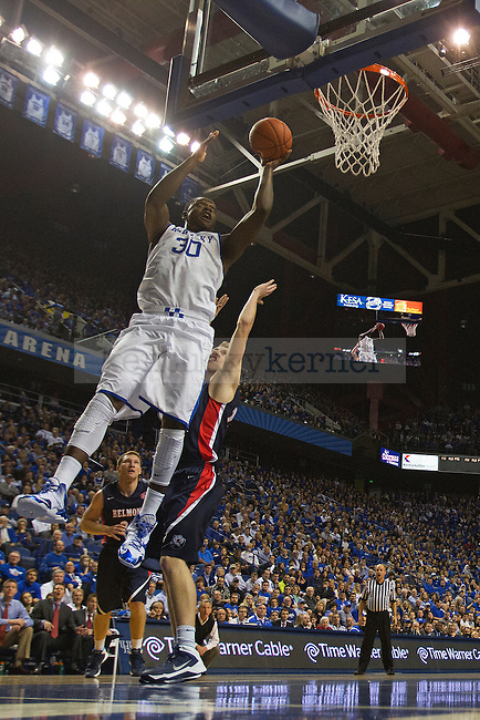 UK forward Julius Randle dunks over the Belmont defender during the first half of the University of Kentucky men's basketball game vs. Belmont University at Rupp Arena in Lexington, Ky., on Saturday, December 21, 2013. Kentucky defeated Belmont 93-80. Photo by Michael Reaves | Staff.