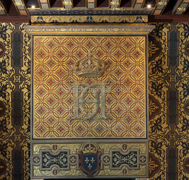 Chimney breast covered with hand-painted wallpaper with the monogram of Catherine de Medici, 2 Cs with an H for Henri II, in the Chambre de la Reine or Queen's Bedroom, decorated in 16th century Renaissance style and restored by Felix Duban in 1861-66, on the first floor of the Francois I wing, built early 16th century in Italian Renaissance style, at the Chateau Royal de Blois, built 13th - 17th century in Blois in the Loire Valley, Loir-et-Cher, Centre, France. This is thought to be the room in which Catherine de Medici died in 1589. The chateau has 564 rooms and 75 staircases and is listed as a historic monument and UNESCO World Heritage Site. Picture by Manuel Cohen