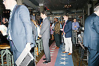 """Jay Faison, Founder and CEO of ClearPath Foundation, (center left) waits to be introduced before a panel put on by the Washington Post called """"Party Platform: Energy and Environment,"""" at Butcher and the Brewer outside the Republican National Convention in Cleveland, Ohio, on Tues., July 19, 2016."""